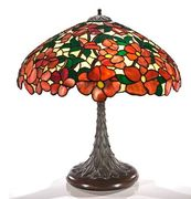 A Suess Ornamental Glass Company leaded glass and patinated bronze lamp