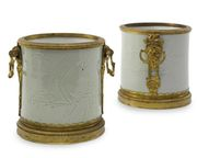 A PAIR OF LOUIS XIV ORMOLU-MOUNTED CHINESE CARVED CELADON PORCELAIN BRUSHPOTS