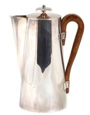 A Tommi Parzinger silverplate and wood coffee pot