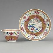 A CHINESE EXPORT FAMILLE-ROSE TEABOWL AND SAUCER