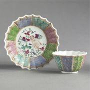 A CHINESE EXPORT FAMILLE-ROSE FLUTED TEABOWL AND SAUCER
