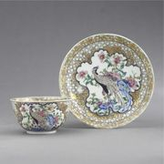 A CHINESE EXPORT FAMILLE-ROSE EGGSHELL TEABOWL AND SAUCER