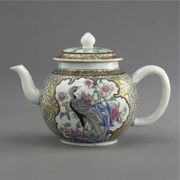 A CHINESE EXPORT FAMILLE-ROSE SPHERICAL TEAPOT AND COVER