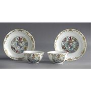 A PAIR OF CHINESE EXPORT ARMORIAL SMALL TEABOWLS AND SAUCERS