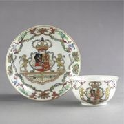 A CHINESE EXPORT ROYAL ARMORIAL TEABOWL AND SAUCER