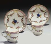 PAIR OF 18TH CENTURY VIENNA PORCELAIN CUPS AND SAUCERS, AND A 20TH CENTURY SILV