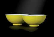 A pair of 18th c. Chinese lemon-yellow enamelled bowls