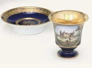MEISSEN BLUE-GROUND TOPOGRAPHICAL CABINET-CUP AND SAUCER