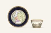 A MEISSEN DOCUMENTARY TOPOGRAPHICAL BLUE-GROUND CABINET-CUP AND SAUCER