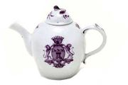 A VOLKSTEDT BULLET-SHAPED ARMORIAL TEAPOT AND A COVER