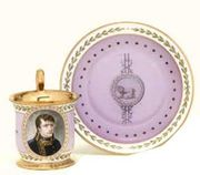 A SEVRES (HARD PASTE) PINK GROUND IMPERIAL PORTRAIT CUP AND SAUCER