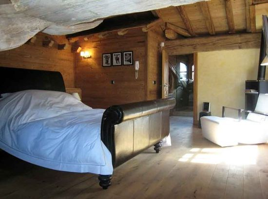 A bedroom in an old luxury chalet